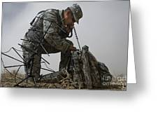 A Soldier Communicates Using A Greeting Card