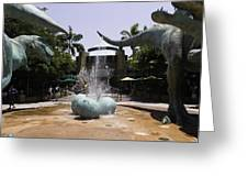 A Water Fountain With Dinosaur Eggs And Dinsosaurs In Universal Studios Greeting Card