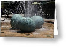 A Water Fountain With Dinosaur Eggs In The Universal Studios Singapore Greeting Card