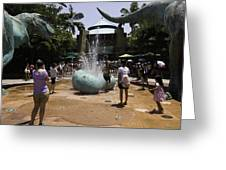 A Water Fountain With Dinosaur Eggs In Universal Studios Singapore Greeting Card