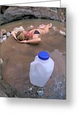 A Water Jug Near A Woman Soaking Greeting Card