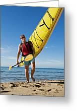 A Woman Carrying Her Sea Kayak Greeting Card