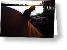 A Woman Exits The Tent At Sunset Greeting Card