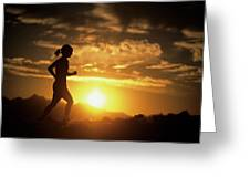 A Woman Jogs Under Sunset Greeting Card