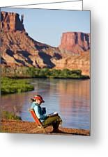 A Woman Reading At A Camp Along Utahs Greeting Card