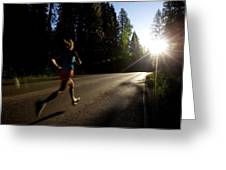 A Woman Running On A Country Road Greeting Card