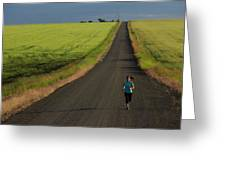 A Woman Running On A Dirt Road Greeting Card