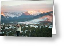 A Woman Stands Against A Snowy Mountain Greeting Card