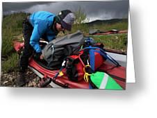 A Woman Unloads Her Kayak Greeting Card
