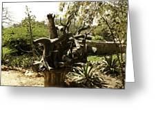 A Wooden Sculpture Inside A Garden Greeting Card
