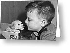 A Young Boy Is Face To Face With A Puppy Tongue. Greeting Card