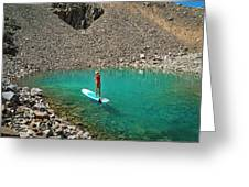 A Young Male Paddleboarding On A Small Greeting Card
