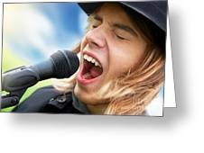 A Young Man Sings To A Microphone Greeting Card
