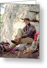 A Young Rock Climber Puts On A Climbing Greeting Card