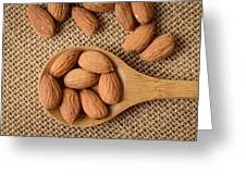 Almonds On A Spoon With Brown Background Greeting Card