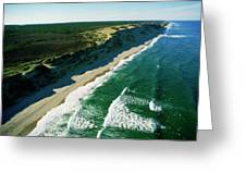 An Aerial View Of Waves Hitting Greeting Card