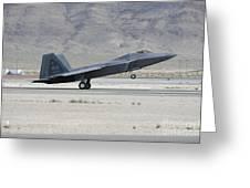An F-22 Raptor Landing On The Runway Greeting Card