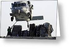 An Mh-60s Sea Hawk Picks Up Supplies Greeting Card