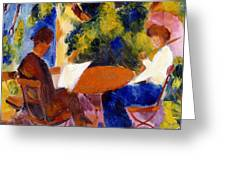 At The Garden Table Greeting Card by August Macke