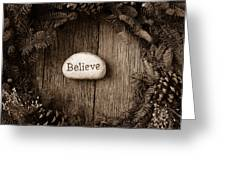 Believe In Text In The Center Of A Christmas Wreath Greeting Card