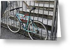 Bicycle Is Chained To A Fence Greeting Card