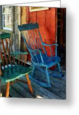 Blue Chair Against Red Door Greeting Card