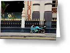Blue Yellow Sporty Motorcycle Parked On Pavement Greeting Card