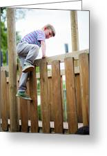 Boy Climbing Over Wooden Fence Greeting Card