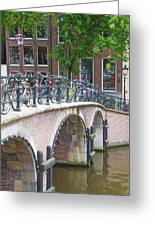 Bridge Over Canal With Bicycles  In Amsterdam Greeting Card