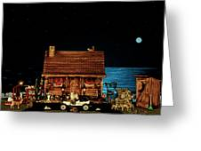 Log Cabin Near The Ocean At Midnight Greeting Card by Leslie Crotty