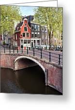 Canal Bridge And Houses In Amsterdam Greeting Card