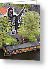 Canal Houses And Houseboat In Amsterdam Greeting Card