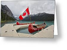 Canoes And Canada Flag At Lake Louise Greeting Card