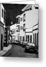 cars parked in a narrow tradtional cobble stone street in Garachico Tenerife Canary Islands Spain vertical Greeting Card