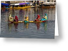 Cartoon - Ladies On A Wooden Boat On The Dal Lake With The Background Of Hoseboats Greeting Card