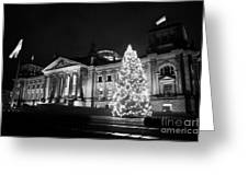 christmas tree and german flag flying fluttering on flagpole outside reichstag building Berlin Germany Greeting Card
