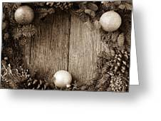 Christmas Wreath With Ornaments And Pine Cones On Rustic Wood Ba Greeting Card