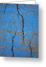 Close Up Of Cracks On A Blue Painted Greeting Card