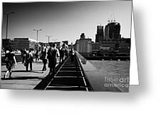 commuters and city workers cross london bridge over the river thames in the morning central London England UK Greeting Card