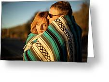 Couple Wraps Themselves In A Blue Greeting Card