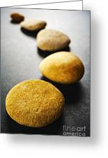 Curving Line Of Brown Pebbles On Dark Background Greeting Card by Colin and Linda McKie
