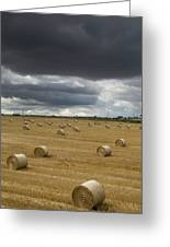 Dark Storm Clouds Over A Field With Hay Greeting Card