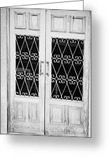 double wooden doors with wrought iron decorative window guards Tenerife Canary Islands Spain Greeting Card