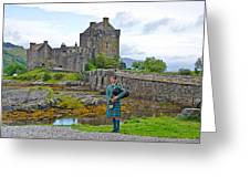 Eilean Donan Castle And The Lone Piper Greeting Card