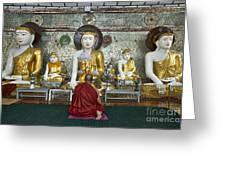 faithful Buddhist monk praying at Buddha Statues in SHWEDAGON PAGODA Greeting Card