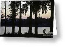 Family Silhouetted By Lake Greeting Card