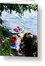 Father And Son Launching Kayaks Greeting Card