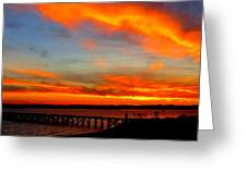 Fiery Skies And Silhouetted Pier Greeting Card by Stephen Melcher