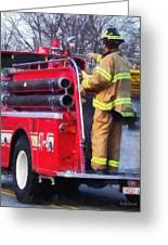 Fireman On Back Of Fire Truck Greeting Card