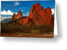 Fluffy Clouds Over Jagged Peaks Greeting Card